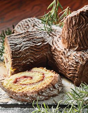Almond-Raspberry Bûche de Noël (Yule Log Cake) with chocolate frosting